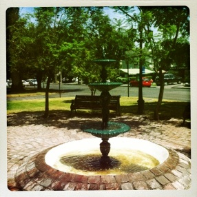 A fountain gracing the sidewalk plaza with its presence!