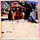 Amanda, lounging at the beach under a palm tree!