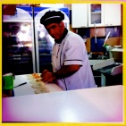 An Empanada stand near the beach, a mug shot of the man making these delicious gooooodies. Yum Yum!