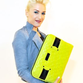 Gwen in all her bright glory-- Neon yellow/green oversized clutch with aquatic blue splashes, jacket and eyeliner!