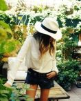 White Hat, Black Trim. White Blouse, Black Denim Shorts.