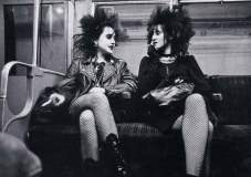 Black on Black. Crazy Big Hair, Ripped Fishnets, Leather, Hardware